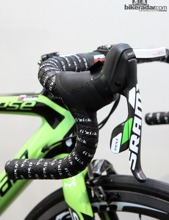 According to Cannondale global road marketing manager Jonathan Geran, the team puts strips of electrical tape around the levers any time the bikes will see time atop the team car so as to keep debris and water out of the shifter internals. The tab up top makes it easy to rip the tape off when necessary