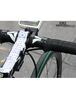 More supplemental shift buttons are positioned up top on John Degenkolb's (Giant-Shimano) Giant Defy Advanced SL. His course notes are so long that they overflow on to the headset cap and stem faceplate. A strip of tape provides a little insurance for his SRM computer, too