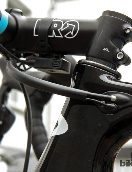 Team mechanics use heat shrink tubing to join the Di2 wire and brake housing together into one neat package