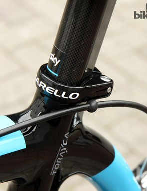 Sky team mechanics use these little rubber balls to keep cable housing from rubbing on the frames