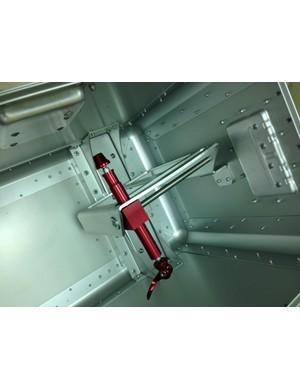 Inside, an adjustable rear axle mount keeps the bike's frame secure