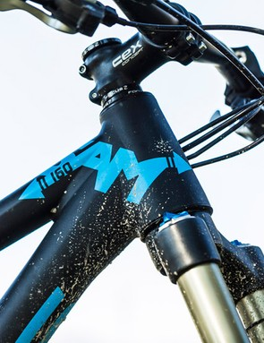 Wide, flat bars and  a short stem command a super-slack front end