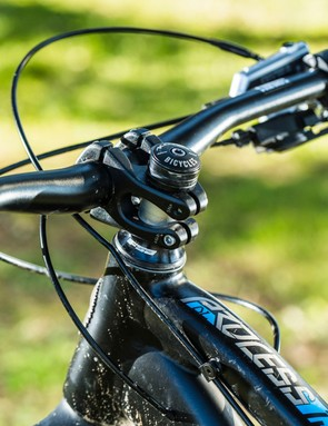 A long top tube and tiny 40mm stem holding the 750mm bars mean this Kona yearns for hard cornering