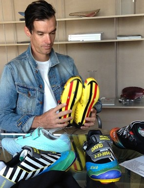 An array of the finished articles before him: shoes for Tirreno-Adriatico, Scheldreprijs, Milan-Sanremo and Flanders