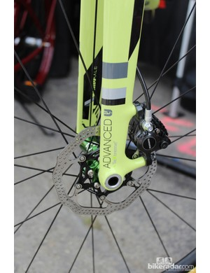 The 15mm thru axle will keep the front wheel aligned in the fork and the rotor aligned in the caliper