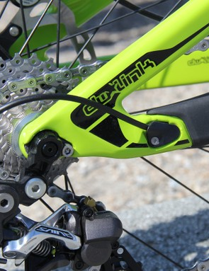 The rear derialluer cable exits through a port on the chainstay