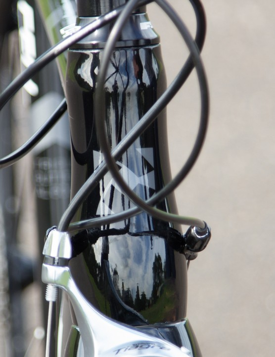 A tapered fork steerer tube provides a solid connection from handlebar to front wheel