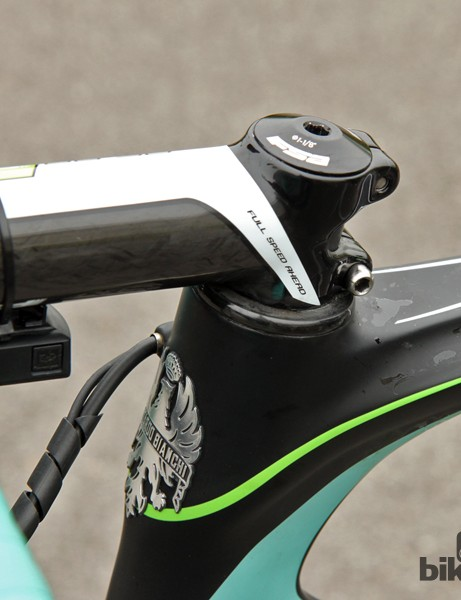 The carbon headset cover is shaved down to yield a few extra millimeters of handlebar drop