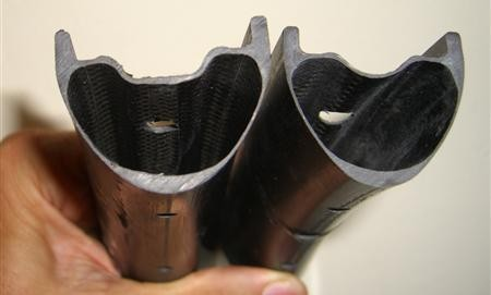 These cutaways of Derby rims show the central drop channel, used to aid in mounting tires, and the raised bead locks on either side of this central channel that prevent the tire from unseating or burping air