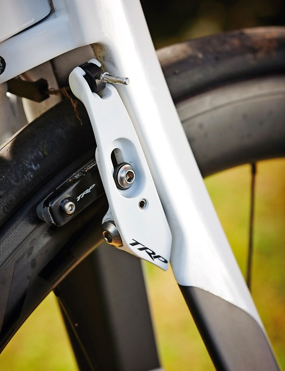 TRP's mini V-brakes are tucked in behind the fork for aero reasons
