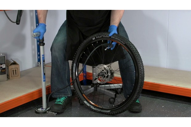 Inflate the tire, ensuring that it is seated evenly around the wheel