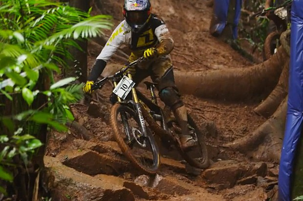 You'd think Gee Atherton would be used to the mud, but he came a cropper on these slippery roots during practice