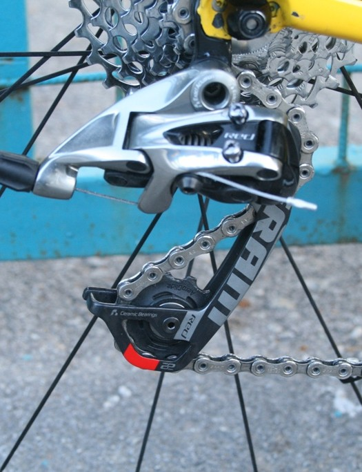 To handle the extra chain slack the cassette produces at the high end, the rear derailleur arm is lengthened