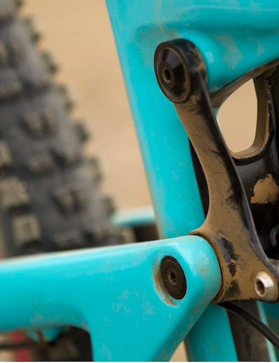The upper link mounts to the junction of the top and seat tubes