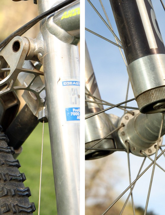 Neither end had any proper damping to speak of. The knobs on the bottom of the fork legs only adjust preload on the elastomer stack