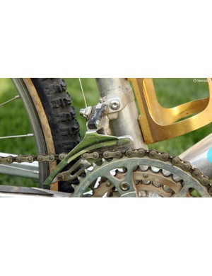 The drivetrain on Travis Brown's 1992 Manitou FS was offset to yield a zero-dish rear wheel. As a result, the front derailleur has to move further from the centerline of the bike than it was originally designed to do. Note the settings on the two limit screws