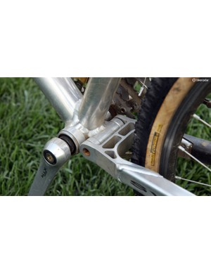 The simple pivot design used composite bushings and press-fit hollow steel axles. The bottom bracket is longer than what Shimano would normally have specified for XTR in order to offset the chainrings to the driveside