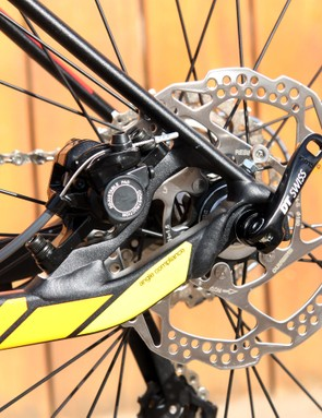 The rear disc brake caliper is neatly tucked away inside the rear triangle