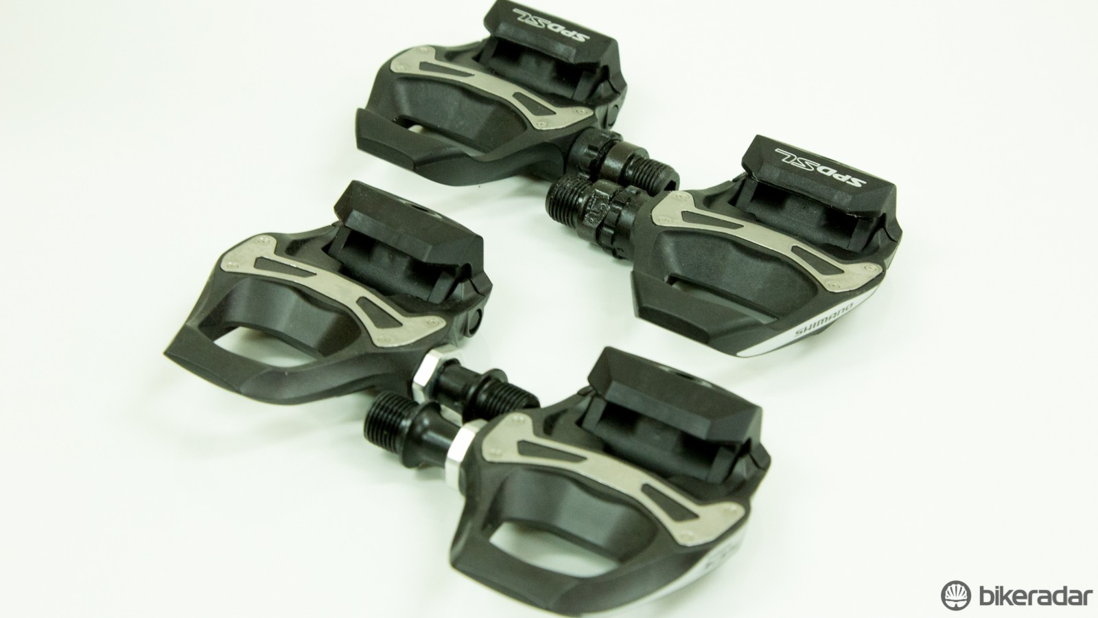 eba1cb92d1f The Shimano R550 SPD-SL pedals (back) are heavier, made of a