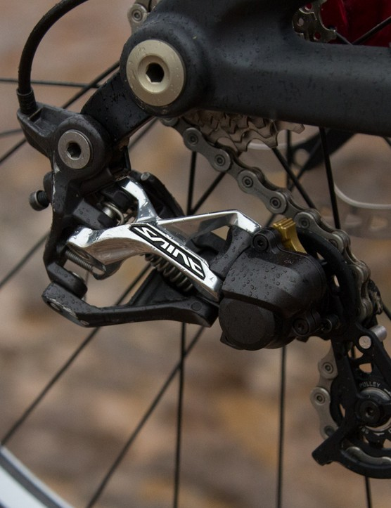 A Shimano Saint Shadow Plus rear derailleur does the shift work