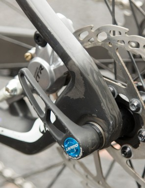 A clean integration of a thru-axle and post-mount rear brake