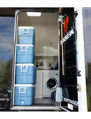 The soigneurs' area of the Trek Factory Racing truck includes a full-sized washer. And yes, there appears to be a bottle of wine on the counter – you never know when it might be time for a celebration!