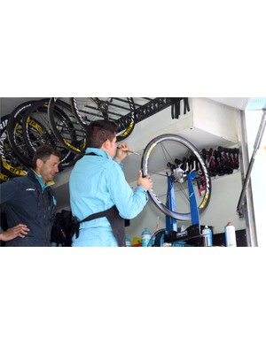Astana team mechanics at least get to glue tubulars 'indoors' - hopefully with the rear door open