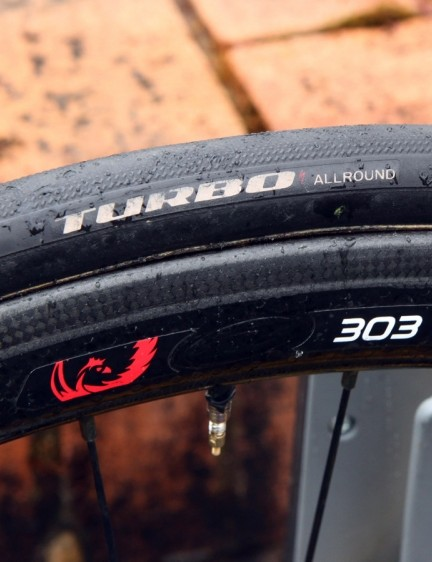 Specialized-sponsored teams are now being supplied with actual Specialized tubular tires, in this case mounted on to Zipp 303 Firecrest carbon wheels