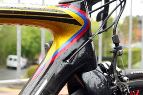 Derailleur cables are fed into the frame just behind the head tube