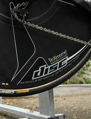 Claimed weight on PRO's Textreme carbon disc wheel is 975g. The wider profile works well with 25mm-wide tyres but it's clearly a tight fit with the rear derailleur
