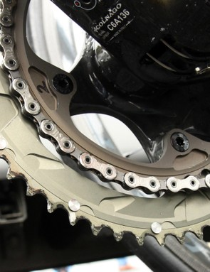 The relatively small chainring bolt circle diameter looks to be compatible with both standard and compact chainrings without having to swap crankarms. Bolts feed in from behind and thread directly into the arm