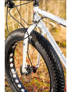 The fork is rigid, and hubs are standard 135mm width