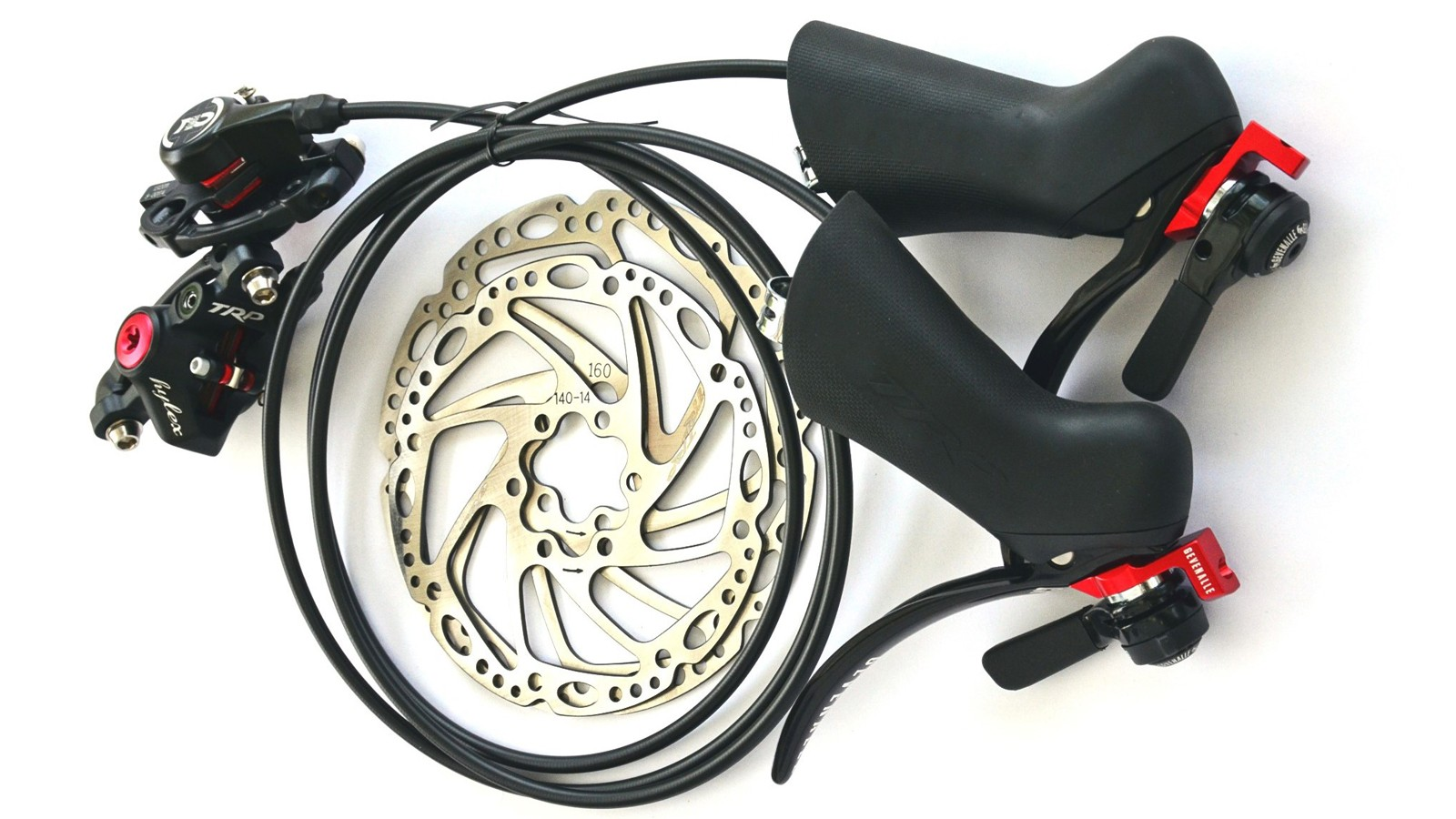 Gevenalle's Hydraulic shift/brake levers use TRP Hylex lever bodies and brake calipers with the company's own lever blades with mounts for thumb shifters