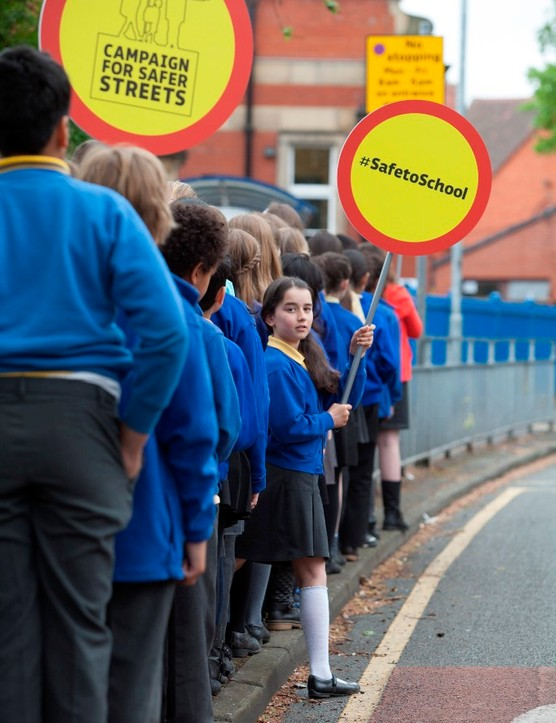 A class of 33 school children, the same number of child cyclists and pedestrians killed in 2012, support Sustrans' Campaign for Safer Streets which launches, today. Lucy Gamble from Manchester holds a lollipop placard backing the campaign
