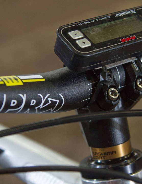 The 10mm stem from Mondraker's in-house brand OnOff helps balance the long top tube and keeps the handling precise. Chris uses a DRC X-Monitor moto timer to help quantify how changes to the bike affect its performance on the trail