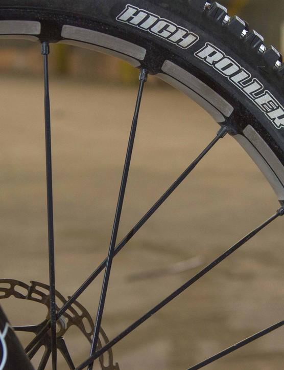 Chris runs a lighter weight Mavic Crossmax SLR wheel and chunky Maxxis High Roller II tyre up front