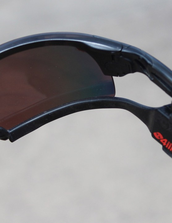 The malleable arm can be placed inside or outside the sunglass lens