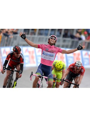Michae Matthews (Orica-GreenEdge) smiles skywards after avoiding a late crash and winning a Giro stage in the pink jersey