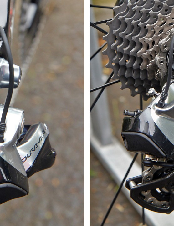 The rear derailleur is mounted to a sturdy, sandwich-type aluminum hanger