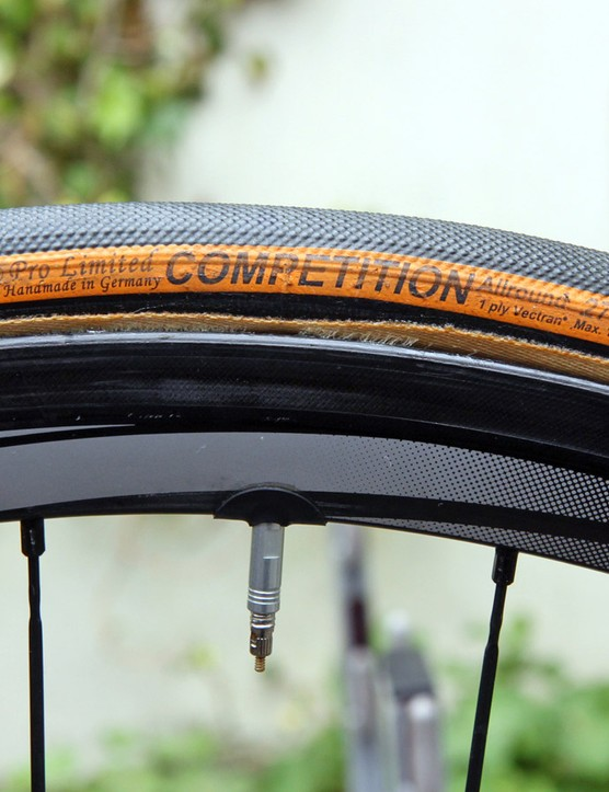 Continental tubulars are glued to the 35mm-deep Shimano Dura-Ace carbon wheels