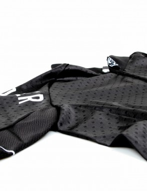Stretchy dimpled fabric is used throughout most of the jersey to provide a snug but comfortable fit