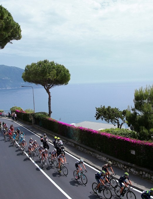 The peloton passes along the Mediterranean coast