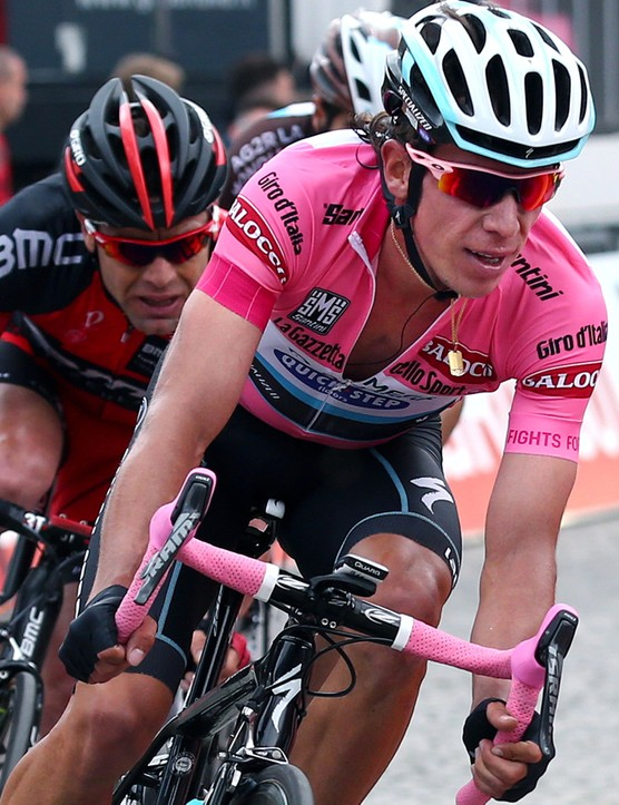 Rigoberto Uran leads Cadel Evans to the line on stage 14