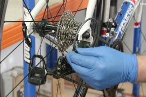Adjust your cable tension using your barrel adjuster until the chain runs smoothly in the second smallest cog