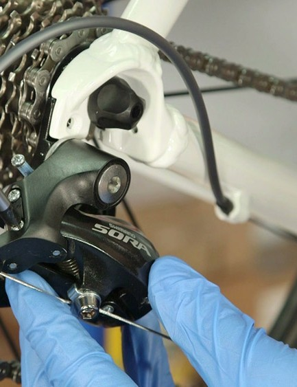 Fully wind in the the lower (L) limit screw and manually push the mech towards the largest cog on the cassette