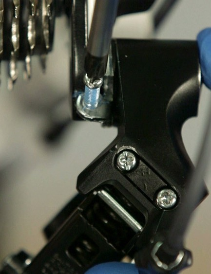 Adjust your jockey-wheel clearance by locating the screw on the top-rear of the derailleur