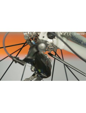 Adjust until there is about 2mm of clearance between the cassette and the upper jockey wheel