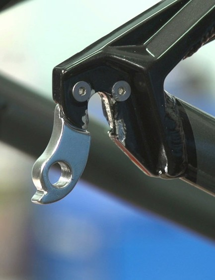 Remove your rear wheel. Then remove the derailleur from the hanger, allowing it to rest on the chain