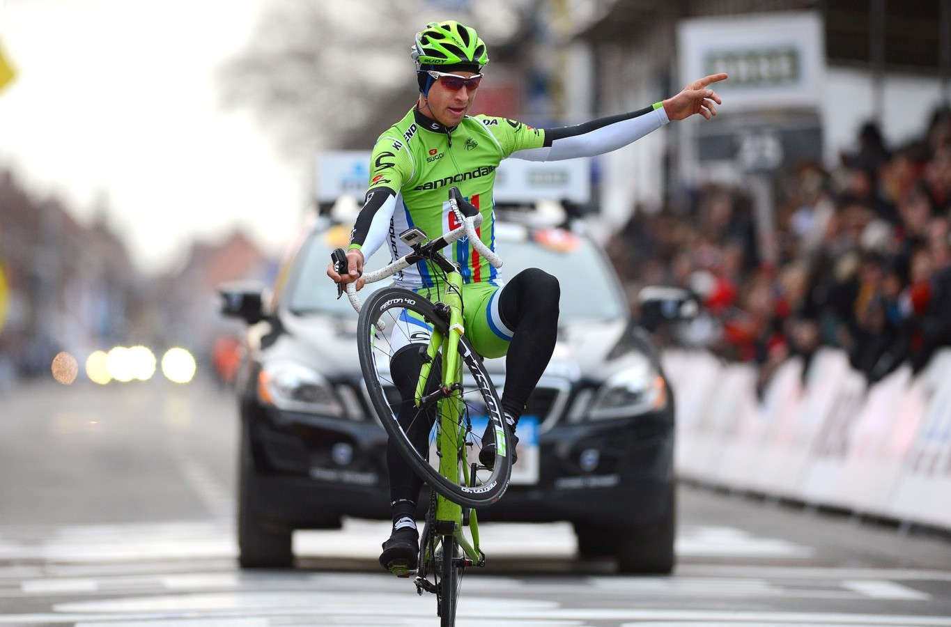 Peter Sagan pulling a wheelie at Gent-Wevelgem in 2013 - a skill he picked up from mountain biking