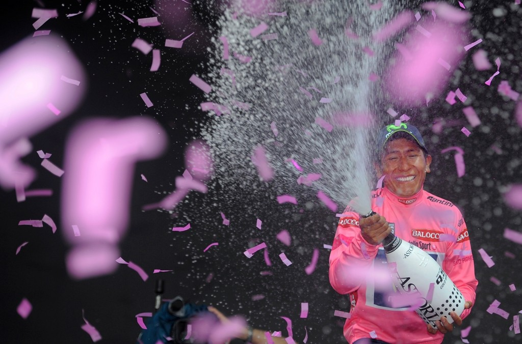 Nairo Quintana (Movistar) sprays the prosecco after clinhing the Giro in Trieste